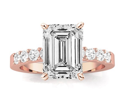 rose gold emerald cut engagement ring with sidestones