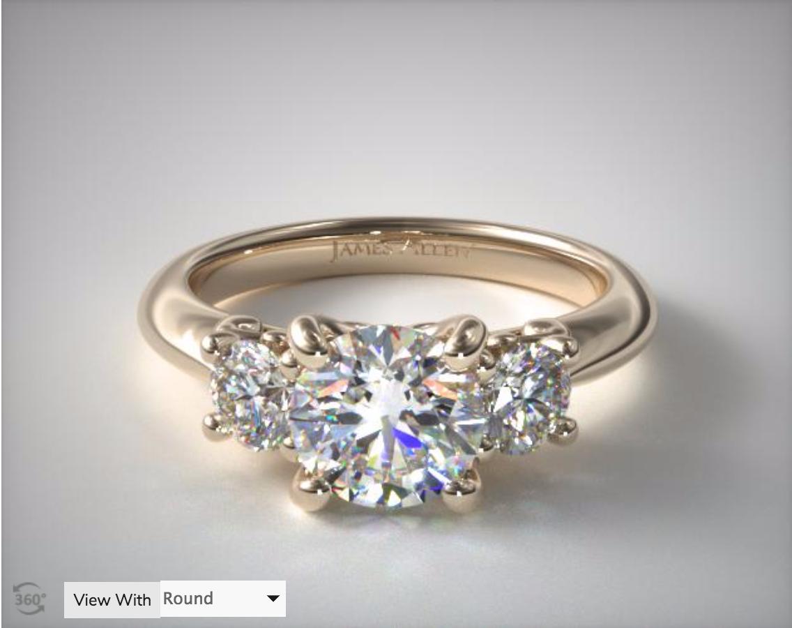 Yellow Gold three-stone ring